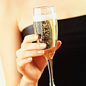 Hand holding a glass of champagne