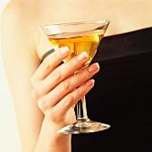 Hand holding martini citroen