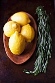 Lemons in a Wooden Bowl with Rosemary