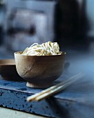 Oriental egg noodle in a wooden bowl