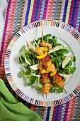 Pork and chorizo kebabs with lamb's lettuce