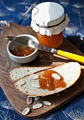 Apple bread with slivered almonds and peach jam