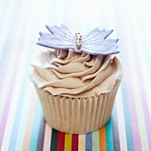 A cupcake decorated with a butterfly