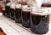 Side view of blackcurrant jam in jars - step shot, blackcurrant jam