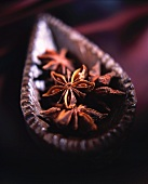 Star anise in a wooden dish