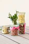Jars containing mixes for pink risotto, mushroom and potato soup, lemon risotto and minestrone
