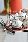Garlic bulbs in a wire basket