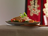Chicken breast on a bed of stir-fried vegetables