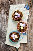 Chocolate and cornflake nests with colourful chocolate eggs