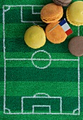 Macaroons (France) with a paper flag and football-themed decoration