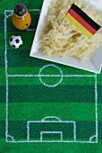 Sauerkraut with a German flag and football-themed decoration