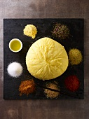 A round pat of butter, olive oil and assorted spices