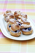Profiteroles filled with blueberries and quark