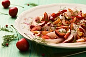 Fish carpaccio with cherries
