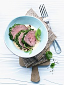 Veal fillet coated in herbs