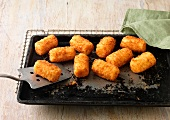 Potato Croquettes on baking tray and wire rack