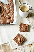 Pecan nut brownies with coffee