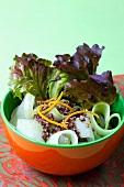 Cucumber salad with red quinoa