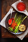 Roasted asparagus with red caviar and black sesame seeds