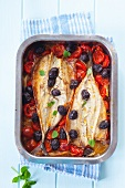Baked mackerel with cherry tomatoes and olives