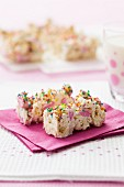 White chocolate and popcorn slices with colourful sugar sprinkles