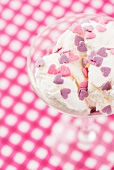 Vanilla ice cream with pink and purple sugar hearts