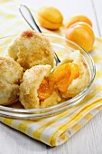 Apricot dumplings with buttery breadcrumb topping and cinnamon sugar