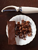 Chocolate curls being created with a peeler