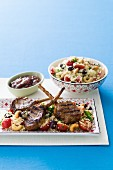 Grilled lamb chops on a bed of couscous salad