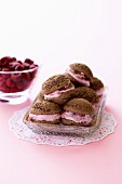 Mini chocolate cakes with raspberry cream filling