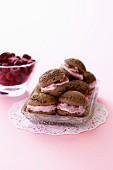 Mini chocolate cakes with raspberry cream filling