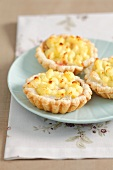 Puff pastry tartlets with camembert and potato mash