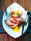 Duck breast with fruit and an orange sauce
