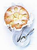 Apple pie topped with icing sugar (view from above)