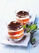 A layered dessert of apple, cream and cocoa powder