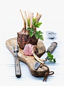 Crown of lamb on a chopping board