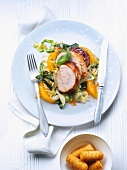 Rolled roast turkey with oranges and pointed cabbage