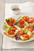 Phyllo dough pizza with cherry tomatoes, mozzarella and basil