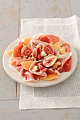 Prosciutto with melons, dates and parmesan