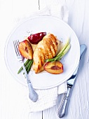 Grilled chicken breast with plums and spring onions