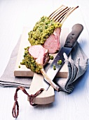Lamb cutlets with a pistachio crust on a cutting board
