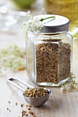 Dried elderflowers in a screw-top jar