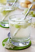 Punch with elderflower syrup and melon balls