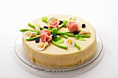 Elegant marzipan layer cake with marzipan flowers