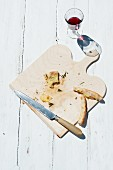 Remnants of potato pizza on a chopping board