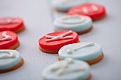 Round marzipan biscuits decorated with letters