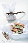 Slices of wholemeal bread topped with herb quark and vegetables