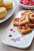 Biscuits on serving dish decorated with postage stamps