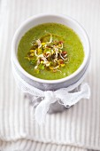 Courgette soup with edible shoots and olive oil