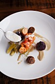 Butter Poached Main Lobster with Braised Fennel, Beets and Porcini Foam